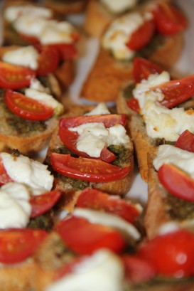 Delicious bruschetta with tomato, pesto and chevre