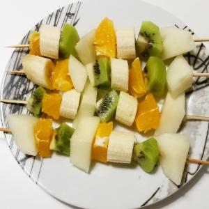 Melon, orange, kiwi and banana