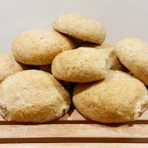 A pile of fluffy, steamy bread rolls