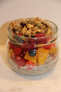 Chia seed porridge with fruits, berries and homemade granola on top.