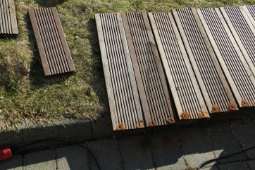 Leftover bamboo boards being prepared to make raised beds