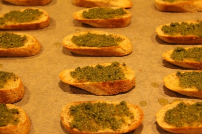 A thin layer of pesto on the slice of bread